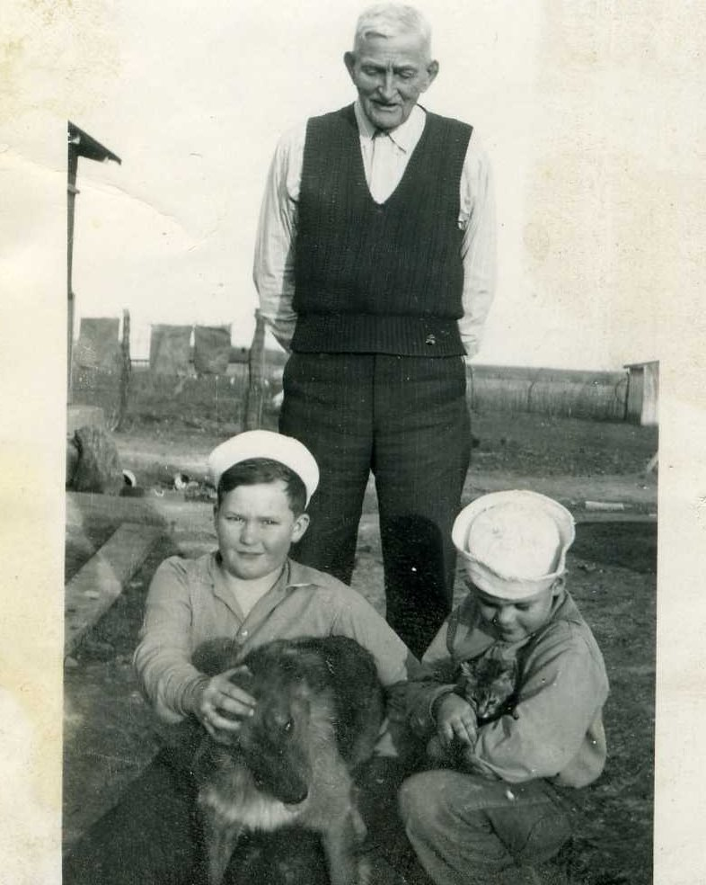 "Roderick Stocking with his great-grandsons Harold ""Fred"" and Gary Stocking, and their dog, Snazzy"