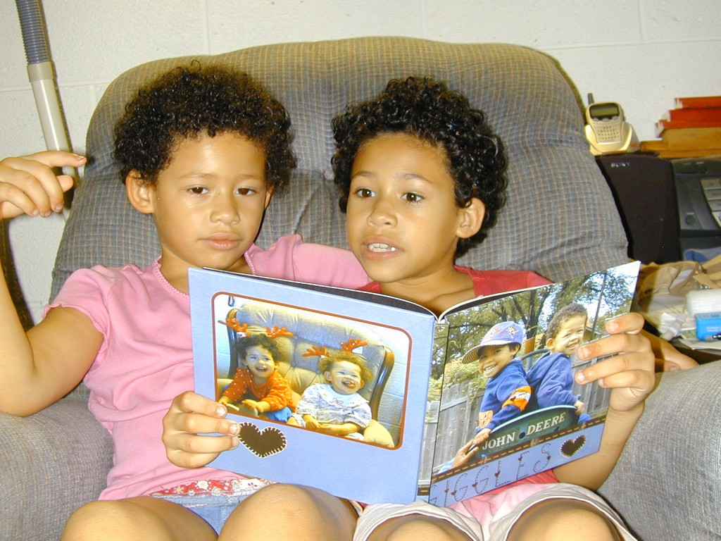 Jordyn reads their storybook to her younger sister, Chloy.