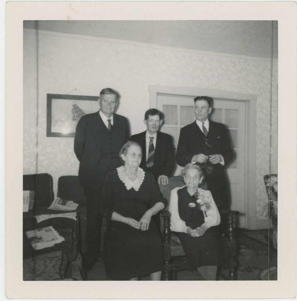 Maggie Corson McGinnis and her four children, left front, Maud, and back, Charles, Eugene, and Virgil McGinnis