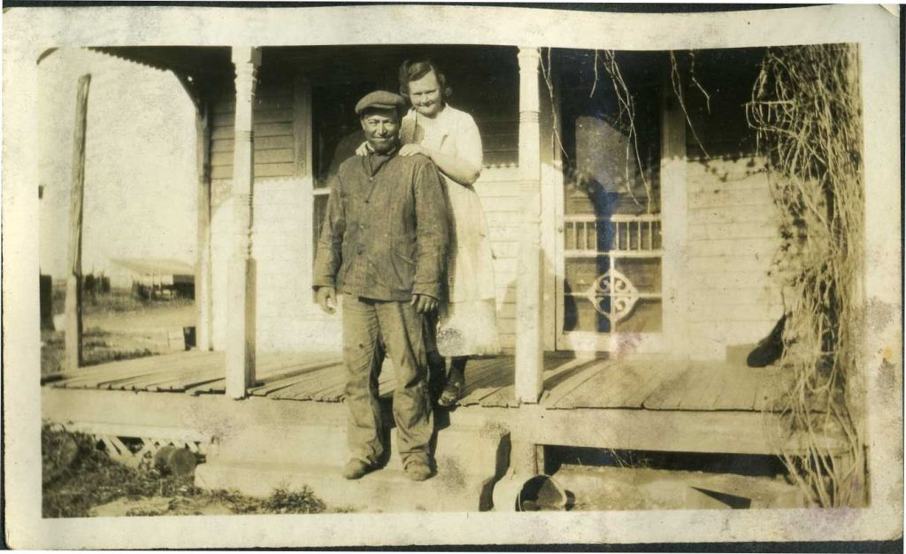 Roderick Porter and Myrtle Nyberg Stocking on the farm near Mayfield, Kansas